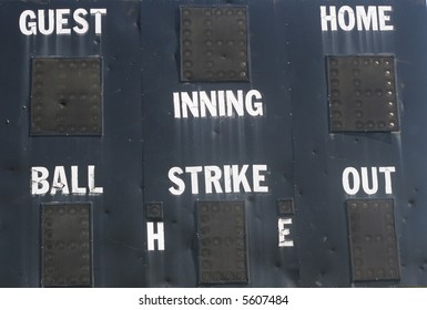 An old electric baseball scoreboard with blank scores