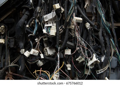 Old electric cables in junkyard