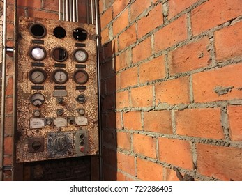 Old electric main distribution board with meter measurement scale and old brick wall in retro house