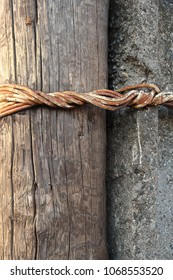 old electric pole, tied firmly, the old texture of wood, concrete, wire