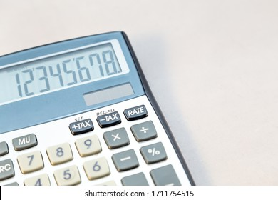 Old electronic calculator on white background