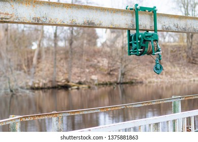 Old electroplate damper on the dam, bridge near the reservoir