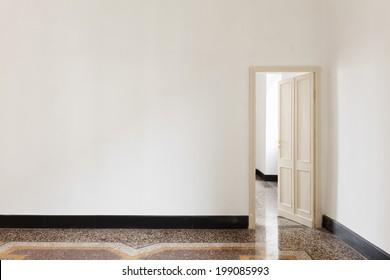 old empty apartment, room view with door
