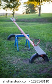 Old empty metal seesaw in an outdoor children's playground