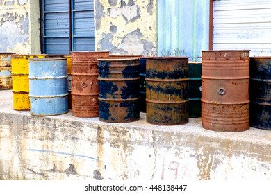 old, empty oil drums rusting by the side of the road