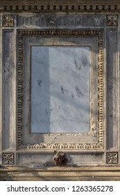 Old empty ornamented marble headstone board in cemetery. Originally blank, no post-processing.