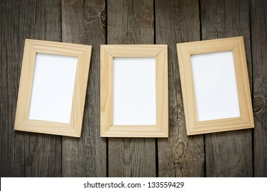 Old empty photos frame on vintage planks background concept