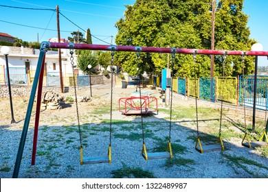 Old empty playground in Greek village on Island of Rhodes (Rhodes, Greece)