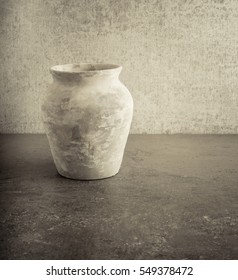 Old empty vase on stone table, still life. Concept of art, pottery object and vintage or antique decorative item.