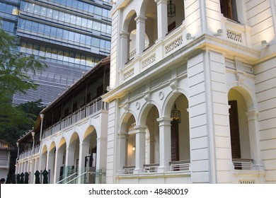 it is a old england style in the front of a modern building.