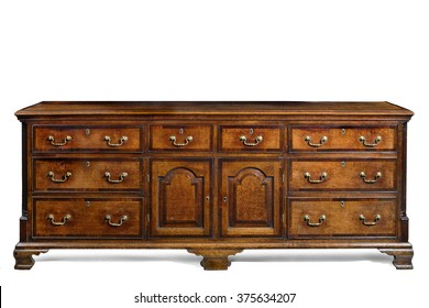 Old English antique oak dresser sideboard base with brass handles isolated with clip path