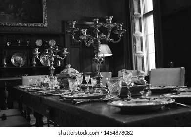 An Old English country house dinner table set for dinner