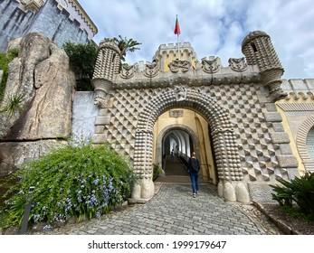 Old entrance with stone archway with arabian ornaments at portuguese medieval tourist landmark Pena Palace (Palácio Nacional da Pena) in Sintra, Lisbon (Lisboa), Portugal, Europe. September 29, 2020.