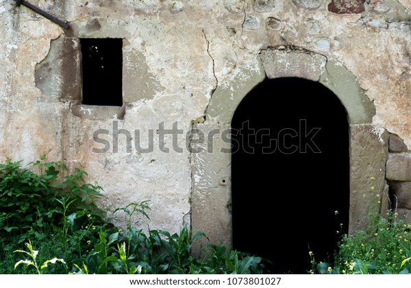 Old entrance stone door and small window in forest