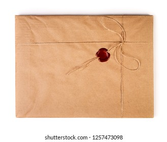 Old envelope with red sealing wax isolated on white background