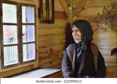 Old epiphany witch dolly sitting in her house