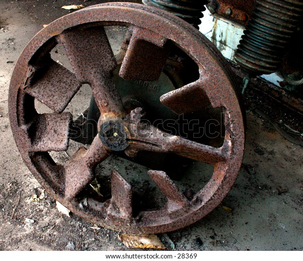 Old equipment in an abandoned cotton mill