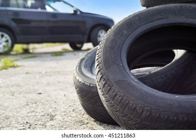 Old erased tires heaped on concrete plates