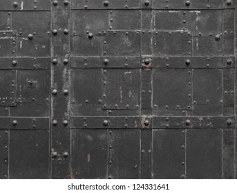 Old european city background - Fragment of antique Iron steel door with strong stack bolts, Vienna, Austria, Central Europe