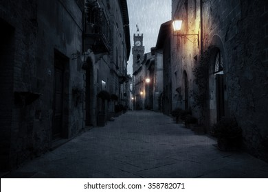 Old European street after dark. Pienza, Tuscany, Italy.