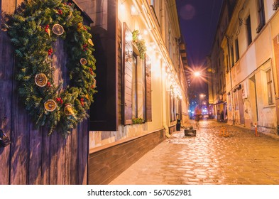 Old european town street cafe at night