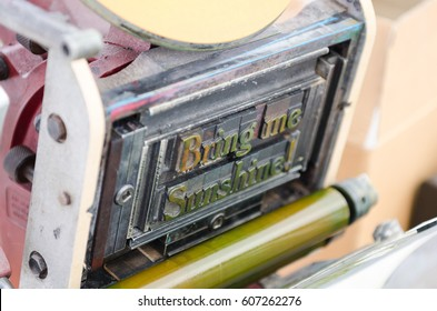 An old excelsior vintage retro type setting machine,  ready to type set print onto paper. Bring me sunshine