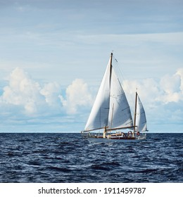 Old expensive vintage two-masted sailboat (yawl) close-up, sailing in an open sea. Coast of Maine, US. Sport, cruise, tourism, recreation, leisure activity, transportation, nautical vessel