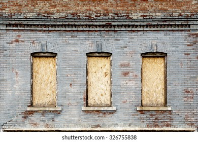 Old Exterior Brick Wall with Boarded Windows