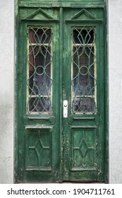 old exterior vintage wood green door with glass close-up