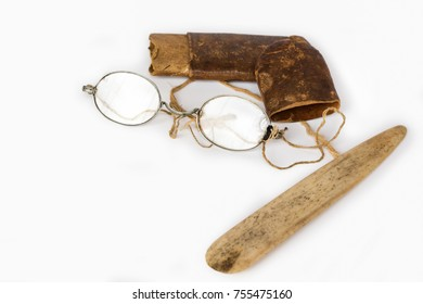 Old eyeglasses with paper case and ivory tab