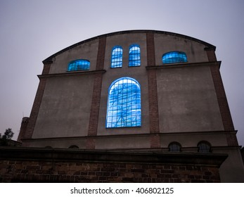 Old facade with blue lit windows