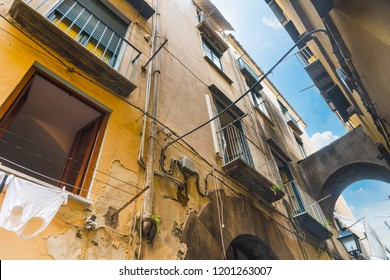 Old facades in a narrow alley in Sorrento, Amalfi coast. Campania, Italy