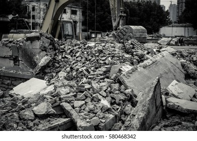Old factory buildings destroyed. Ruins of industrial enterprise, dark debris destroyed factory premises in factory as result of economic crisis and earthquake.