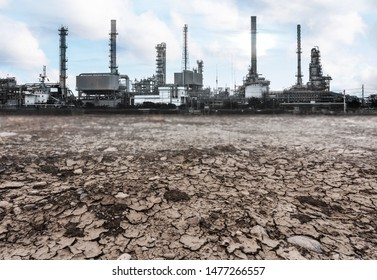 Old factory over dry cracked ground. Pollution and environmental problems - Shutterstock ID 1477266557