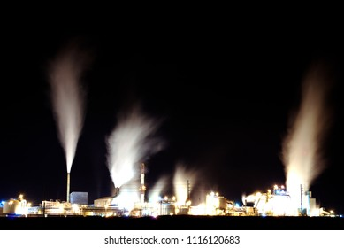 Old factory pumping out pollution and steam through smokestack