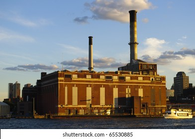 Old factory seen from ferry outside of Manhattan, New York City, New York.