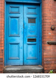 Old faded blue wooden doors