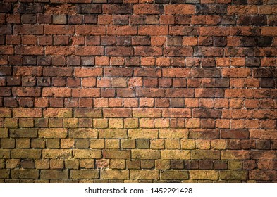 An old  faded garden brick wall background.