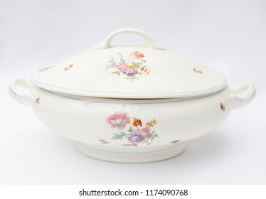 Old faience soup bowl with topper isolated