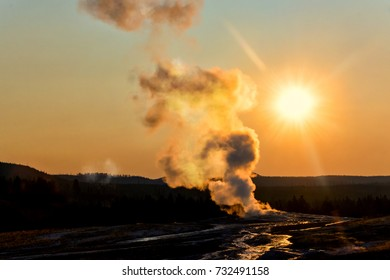 Old Faithful geyser at sunrise in Yellowstone National Park
