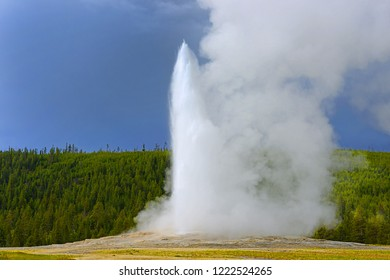 Old Faithful Geyser, Upper Geyser Basin, Scenic Landscapes of Geothermal activity of Yellowstone National Park, USA, UNESCO World Heritage Site