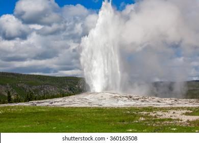 Old Faithful Geyser in Yellowstone National Park erupting