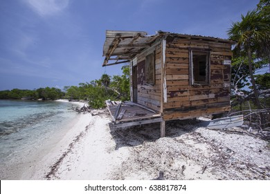 An old  falling down fishing shack on the beach of caye in Belize