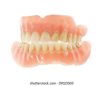 Old false teeth isolated on white