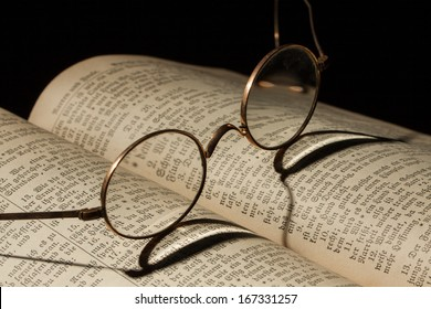 Old Family Bible with eyeglasses