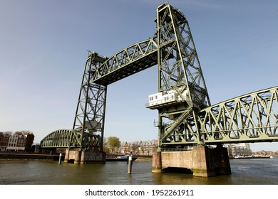 """Old famous and monumental Koningshavenbrug (""""De Hef) in Rotterdam, The Netherlands. This iconic lifting railway bridge is one of the landmarks of Rotterdam."""