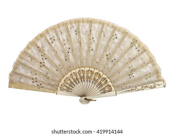 Old fan with lace, open and isolated on a white background