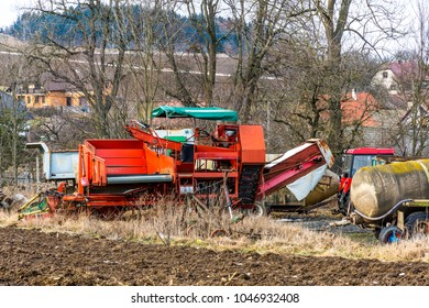 Old farm agriculture technology, metal machines and vehicles. Near the field and countryside land.