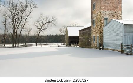 Old farm buildings in snow
