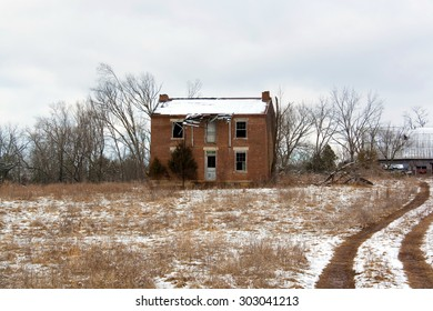 An old farm house in the winter.